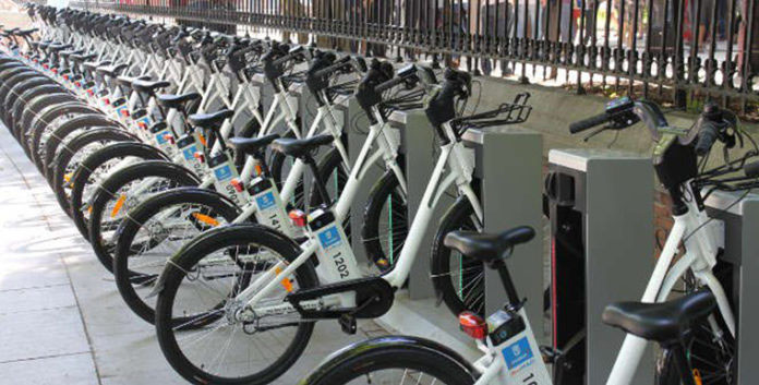 Image of BiciMAD with a large number of electric bicycles for public use from the Madrid Council